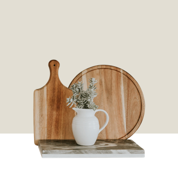 Housewares, cutting boards and ceramic jar with plant